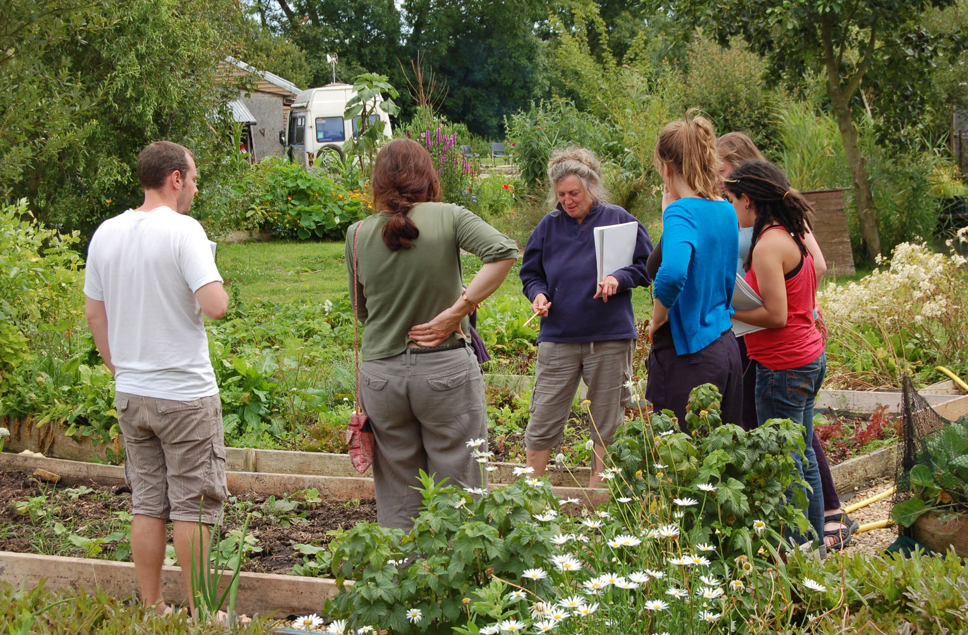 Pat teaching in veg garden close